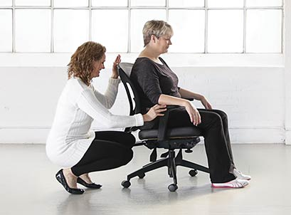 woman siting on workplace chair